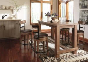 Pinnadel natural wood finish counter table with swivel seat bar stools in a kitchen next to a window.