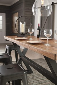 angled view of Glosco two tone wood table and metal backless stools