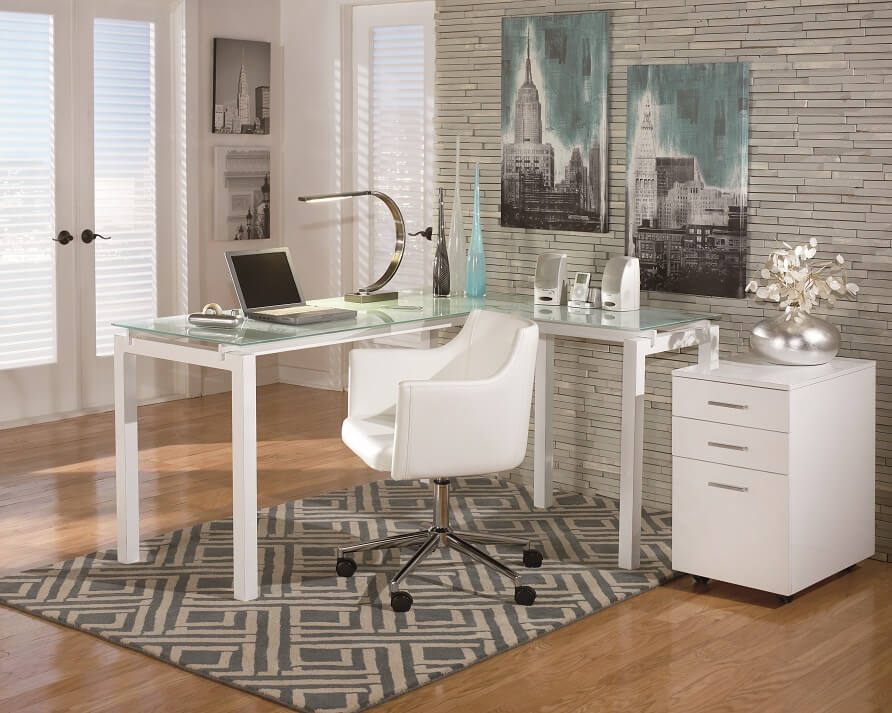Simple and sleek home office desk with chevron gray rug with matching filing drawers.