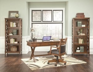 Burkesville home office desk with large bookcases in a large home office with a window in the middle.