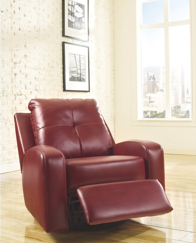 The Red Mannix DuraBlend Swivel Glider recliner in an empty room with windows and lily pad photographs on the wall behind the recliner.