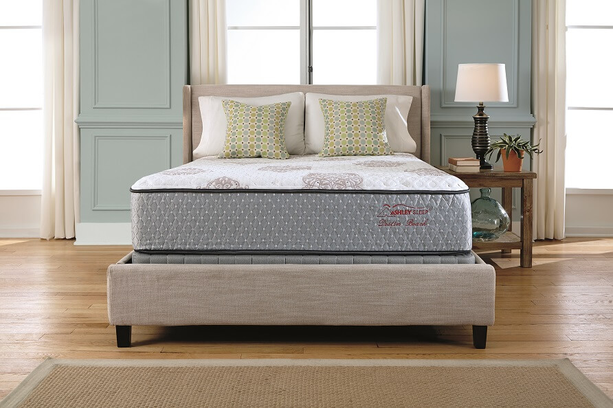 Ashley sleep mattress in an empty room with 3 windows and a lamp