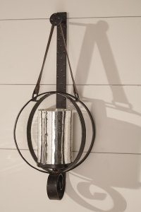 wall sconce made with dark brown metal circles and mercury glass