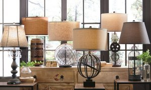 metal and glass table lamps on a console table