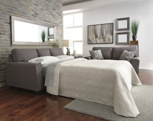 Contemporary pull out sofa in a chic gray with flared arms