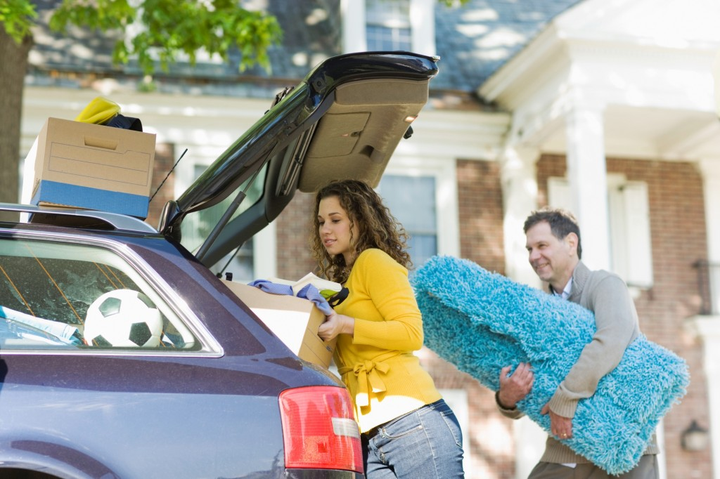 Young Woman and Father Loading the Car