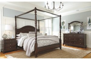 lavidor king canopy bed, dark wood, light bedding, set in a bedroom