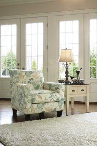 Daystar chair with floral print and pastel colors.