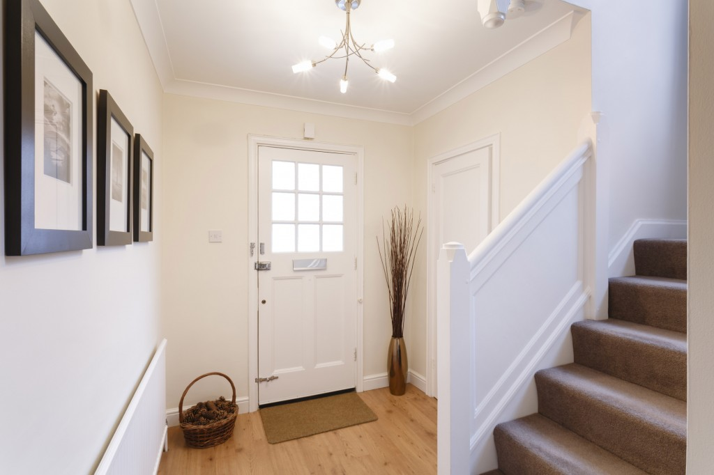 Interior of a white mudroom and carpeted stairs