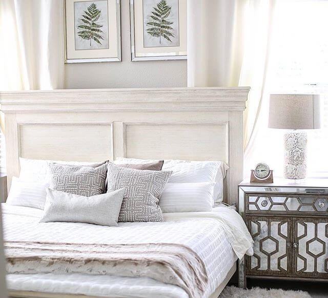 distressed vintage inspired panel queen bed in bedroom setting