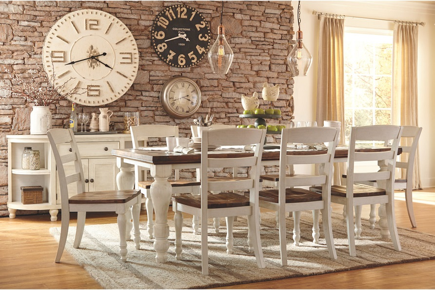 Farmhouse Style Dining Room Table And Chairs With Rustic Chic Clocks On The  Back Wall.