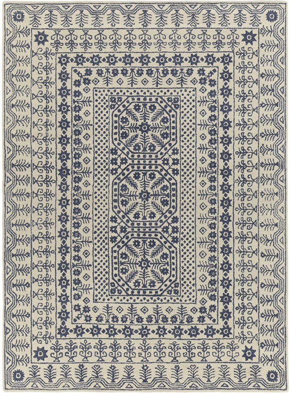 Navy blue Moroccan patterned area rug.
