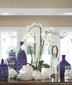 White dinnerware accented by blue ceramic vases.