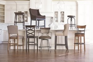 Assortment of barstools in a white kitchen with wood floors.