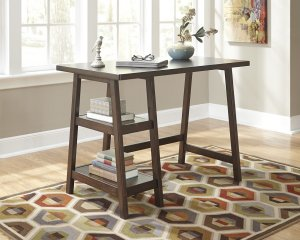 Lewis Home Office Desk with storage shelves on one side. It is very sleek and clean, underneath it is a hexagon patterned rug with various colors.