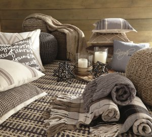 assorted accessories such as throws, pillows, candles and decor pieces.