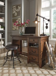 The Woodboro traditional looking lift top office desk with Shayneville swivel stool in an office room with flower canvas on the wall and desk lamp on the desk,