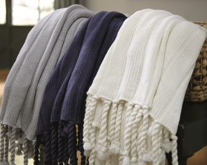 column knit throw blankets available in solid gray, blue or white