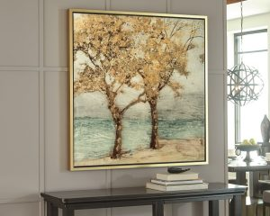 trees in a seascape large wall art on a wall above a console table.