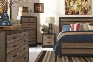 modern chic vintage gray and dark brown king bed set with dresser, night table and rug.