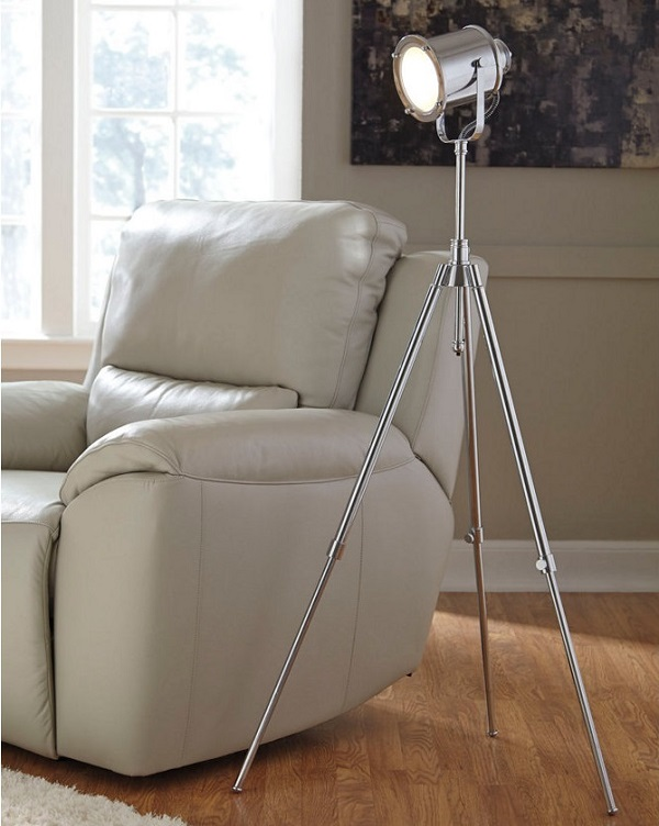 And ashley floor lamp standing next to a recliner