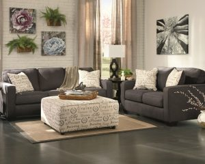 Charcoal black Alenya couch, oversized ottoman, and loveseat in a casual living room set
