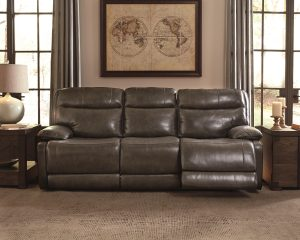 Leather reclining sofa with dim lights and masculine vibe with a map in a frame on a wall.