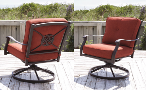 Two red swivel chairs on a deck overlooking the beach.