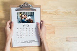 Calendar clipped onto a brown clip board