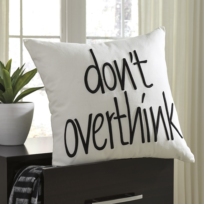 "White throw pillow with text, ""dont over think"""