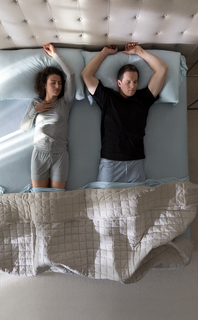 Two celebrity athletes sleeping face up on a tempur-pedic mattress.