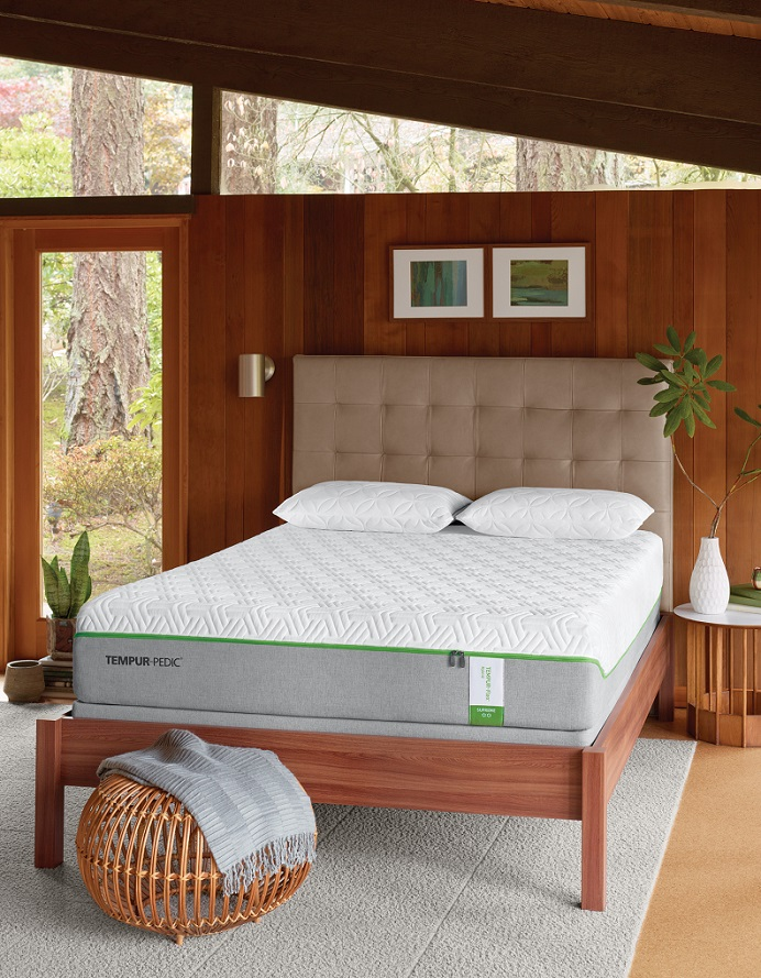 Tempur-pedic mattress on a wooden bed frame in a bamboo style bedroom.