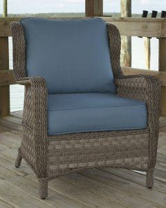 Blue woven wicker cushioned lounge chair.