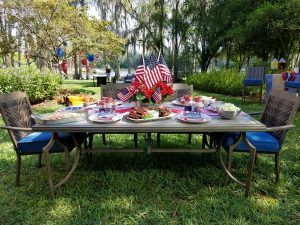 4th of july table setting outdoor under the trees.