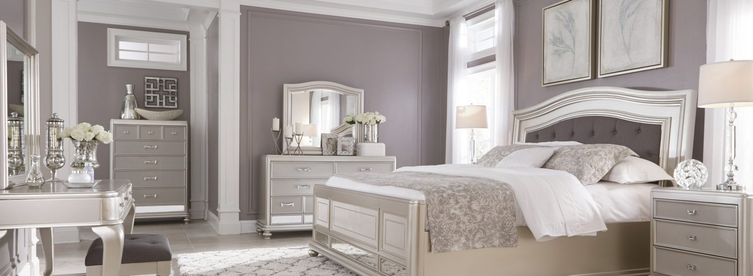 Coralayne upholstered silver bed frame and furniture set with vanity