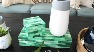 Decorative containers group together on a coffee table.