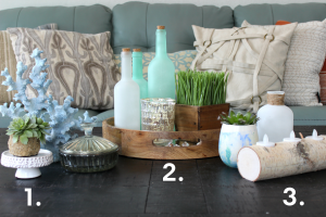 Coastal coffee table display with 3 sets of decor.