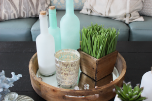Close up of glass bottles used to decorate a coffee table.