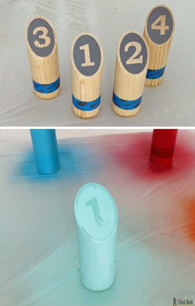 A molkky game set being spray painted.