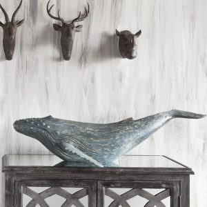 Blue whale coffee table decor for coastal theme home decoration ideas.