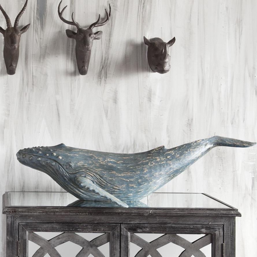 Blue whale coffee table decor for coastal theme home decoration ideas.