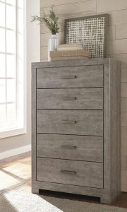 Gray wooden textured drawer chest with beachy decor on top
