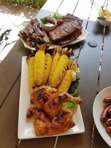 Grilled food staged on an outdoor table for 4th of july.