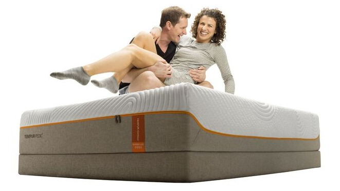 Professional snowboarder and volleyball player on a tempur-pedic mattress being goofy.