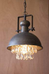 Metal pendant lamp with crystals hanging from light.