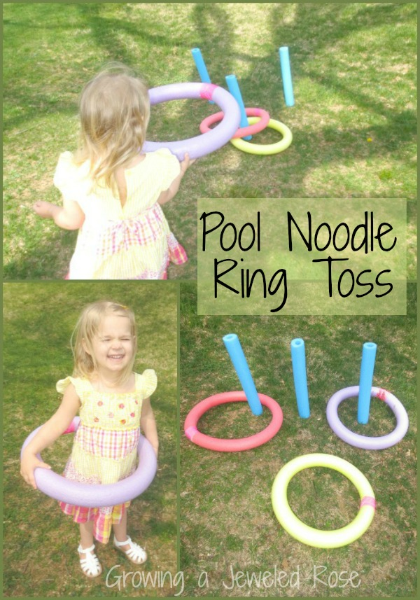 Pool noodle ring toss being played by a little girl in the yard.