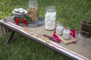 Smores bar outside during a 4th of july barbecue.
