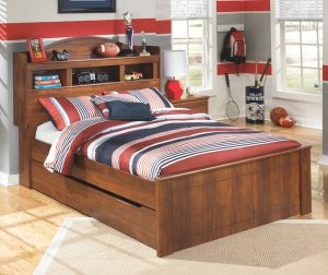 Brown twin bed for little boys room with extra drawers for storage.