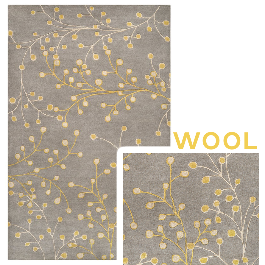 Wool rug with ferns and flowers designed on it.
