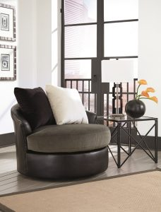 Black swivel chair in a small space with fluffy chairs on top.